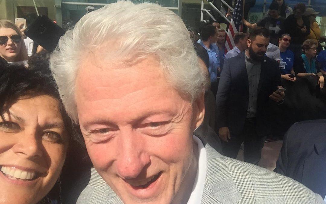 Vivian Hartman delivers Sophia's Angels package to Bill Clinton